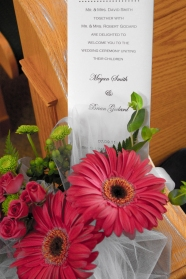 Aisle bouquets and program for the wedding.